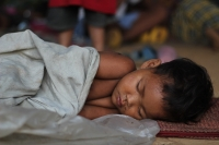 This Mangyan child slept peacefully despite the early morning hustle and bustle of the first day of the Mangyan Day activities. (Photo Mark Ambay III)