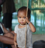 This Mangyan child holds the stick like she knows how to use it. If you look closely, you'll also notice that she's holding something in her right hand. It's a knife. For many indigenous groups, every man, woman and child has a duty to defend their land and community should they be attacked by enemies. (Photo Mark Ambay III)