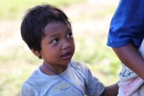 A Mangyan child wonderingly looks at visitors.