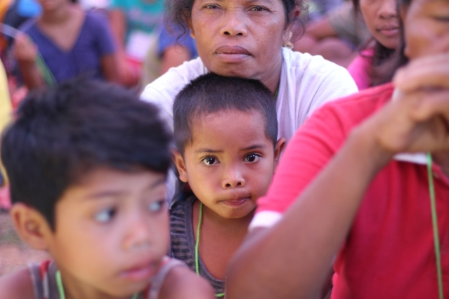 A Mangyan child held by his mother during the discussion on Mangyan self detrmination. (Photo Mark Ambay III)