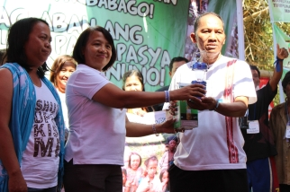 The Mangyans accept the donation of solar lamps from ACT Teacher's Party List. (Photo Mark Ambay III)