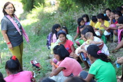 Mangyan women and girls discuss the situation of indigenous women with Kakay Tolentino (left, standing) of BAI Indigenous Women's Network. (Photo Mark Ambay III)